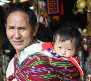 Father Carrying Child in National Dress. © Sharon Lundahl